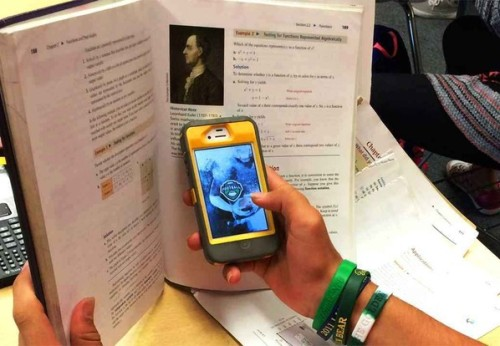 CellphoneHidingBehindBookjpg